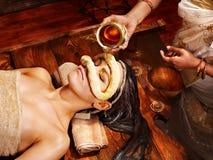 Woman having mask at ayurveda spa. stock photo