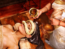 Woman having mask at ayurveda spa. Royalty Free Stock Images