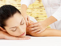 Woman having massage of body in spa salon Royalty Free Stock Photo