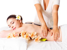 Woman having massage of body in spa salon Royalty Free Stock Image