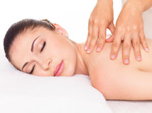 Woman having massage of body in spa salon Stock Image