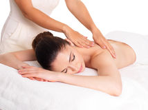 Woman having massage of body in spa salon Stock Photos