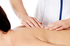 Woman having massage of body in the spa salon. Beauty treatment concept. Royalty Free Stock Image