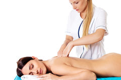 Woman having massage of body in the spa salon. Beauty treatment concept. Stock Image