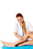 Woman having massage of body in the spa salon. Beauty treatment concept. Royalty Free Stock Photography