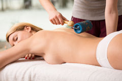 Woman having massage done. Beauty woman having massage done by massager Royalty Free Stock Images
