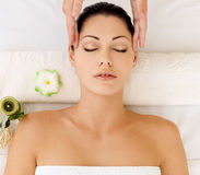 Woman having massage of face in spa salon Royalty Free Stock Photo