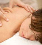 Woman having a massage on her back Stock Images