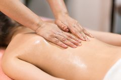 Woman Having Massage With Massage Oil In A Spa. Woman Having A Massage With Massage Oil In A Spa royalty free stock photos