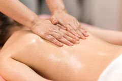 Woman Having Massage With Massage Oil In A Spa. Woman Having A Massage With Massage Oil In A Spa stock photography