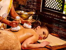 Woman having massage with pouch stock image