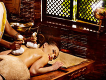 Woman having massage with pouch of rice. Royalty Free Stock Photos