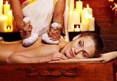 Woman having massage with pouch of rice. Stock Photos