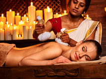 Woman having massage with pouch of rice Royalty Free Stock Photography