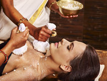 Woman having massage with pouch of rice Stock Image