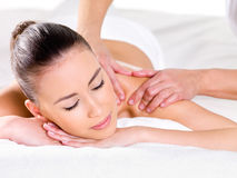 Woman having massage on shoulder stock photography