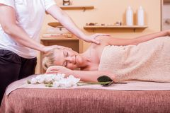 Woman having massage in spa stock photo