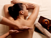 Woman having massage in the spa salon Stock Images