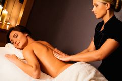 Woman having massage in a spa salon Stock Image