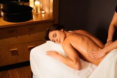 Woman having massage in a spa salon Royalty Free Stock Photography