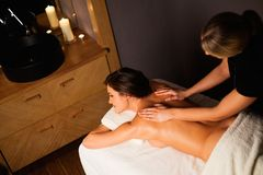 Woman having massage in a spa salon Royalty Free Stock Image