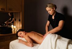 Woman having massage in a spa salon Stock Image
