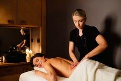 Woman having massage in a spa salon Stock Photos