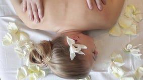 Woman having massage in the spa salon. Body care. stock video