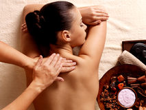 Woman having massage in the spa salon. Masseur doing massage on woman body in the spa salon. Beauty treatment concept Stock Photos