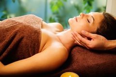 Woman having massage in a spa salon Royalty Free Stock Images