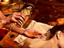 Woman having massage spa treatment. Young woman having oil massage spa treatment Royalty Free Stock Images