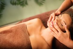 Woman having massage in a spa Stock Photo
