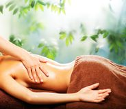 Woman having massage in a spa Royalty Free Stock Photography