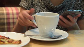 Woman having meal in cafe and using mobile stock footage