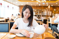 Woman having meal in chinese restaurant Royalty Free Stock Photography