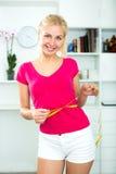 Woman having measuring tape around her waist Royalty Free Stock Photo