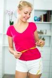 Woman having measuring tape around her waist Stock Photos