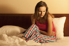 Woman having menstrual pain Royalty Free Stock Photography