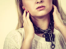 Woman having metal chain around neck Stock Photo