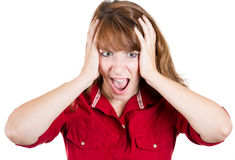 Woman having a migraine / headache holding her head in pain and stress Stock Images