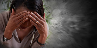 Woman having a migraine headache. Stock Image