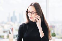 Woman having mobile phone conversation Royalty Free Stock Image