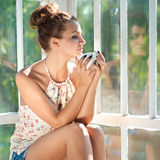 Woman having morning cup of coffee or tea Royalty Free Stock Photo