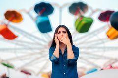 Woman Having Motion Sickness on Spinning Ferris Wheel Background stock image