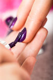 Woman having a nail manicure in a beauty salon Stock Image
