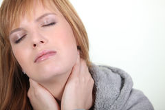 Woman having a neck ache Stock Images