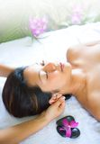 Woman having neck massage. Therapy in spa royalty free stock photo