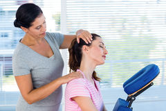 Woman having neck massage. In medical office stock image