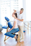 Woman having neck massage Stock Image