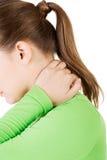 Woman having neck pain massaging herself Royalty Free Stock Photos